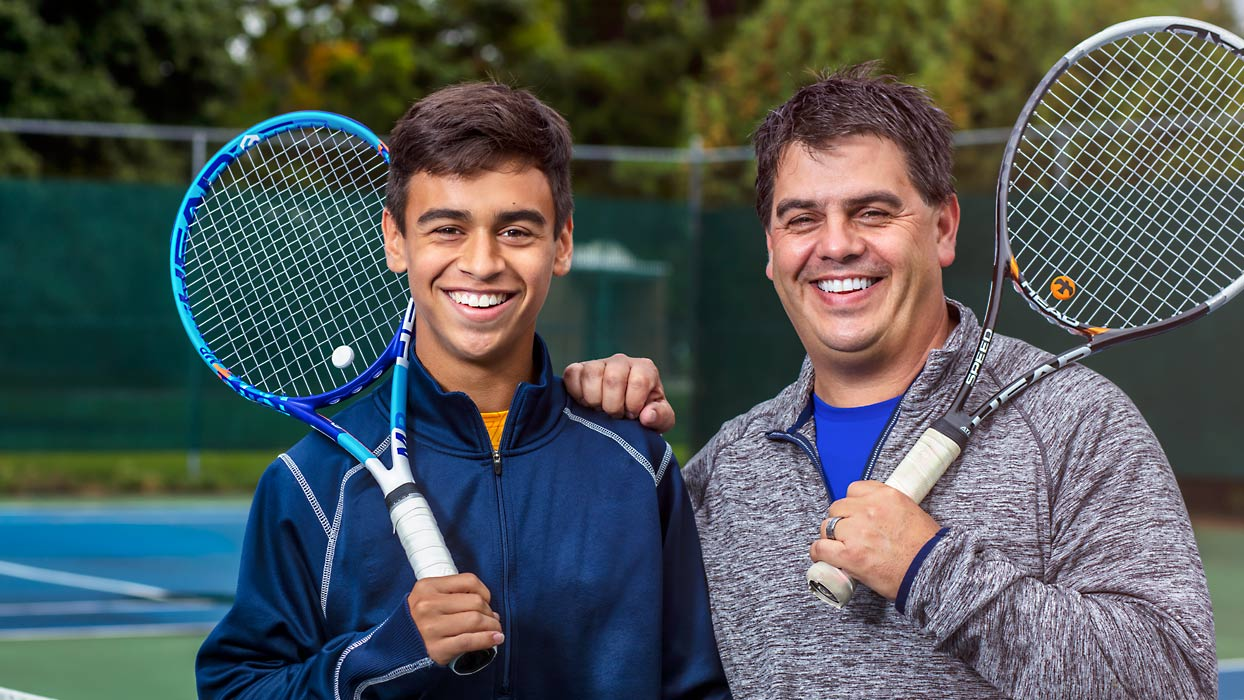 Father & son at tennis court